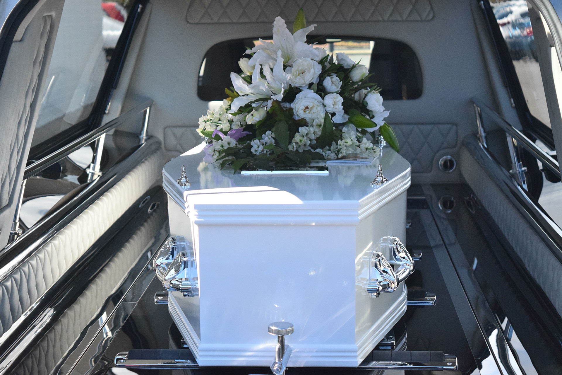 Coffin in Back of Hearse